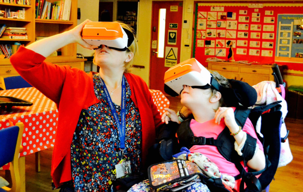 student and support worker with virtual goggles