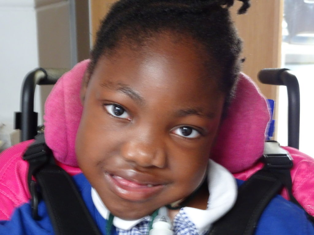 Portrait of a young girl in a wheelchair