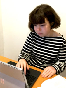 Young woman typing
