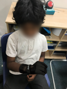 Boy with signing glove