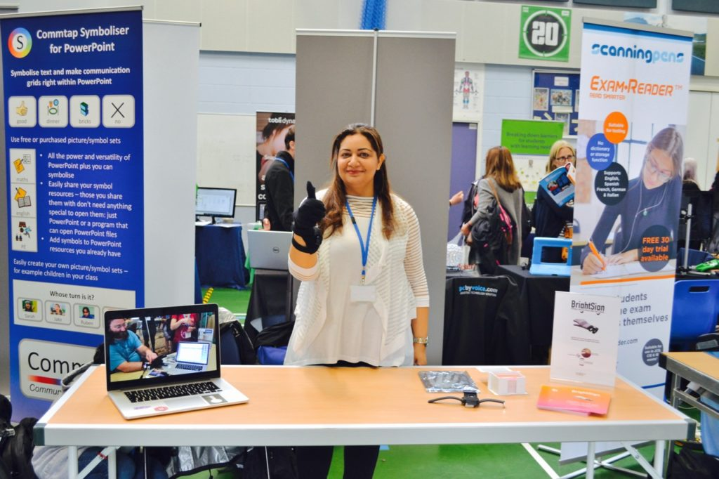 Woman at a trade show showing her signing device